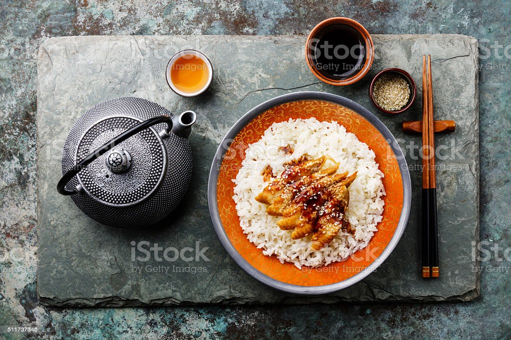 Eel with sauce and sesame on Rice and green tea stock photo