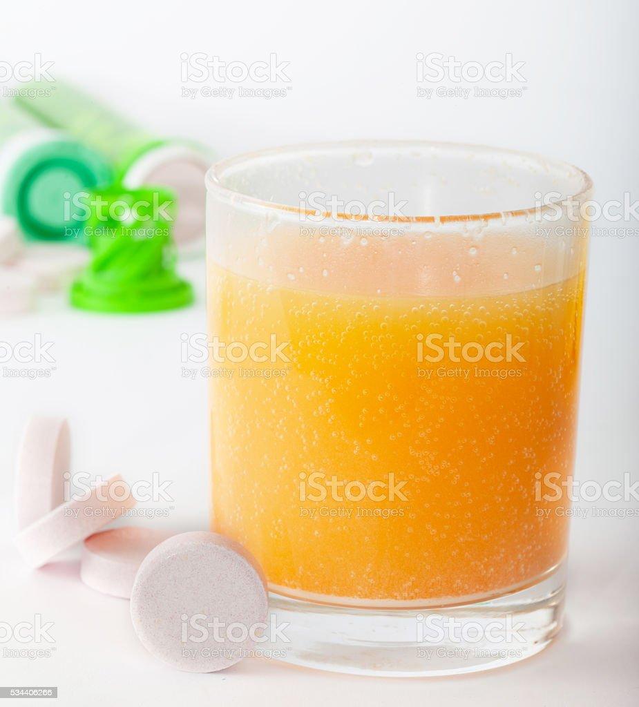 Effervescent calcium tablets juice stock photo