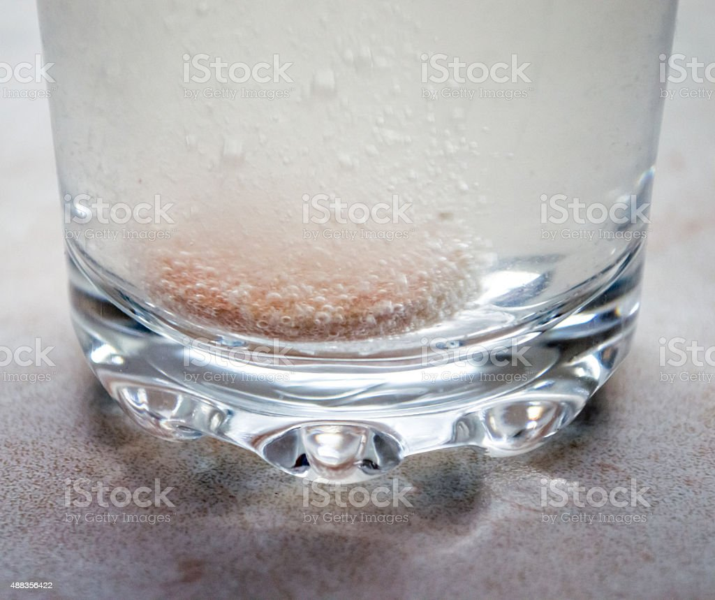 Effervescent/Fizzing Tablets/Pills in a Glass of Water royalty-free stock photo