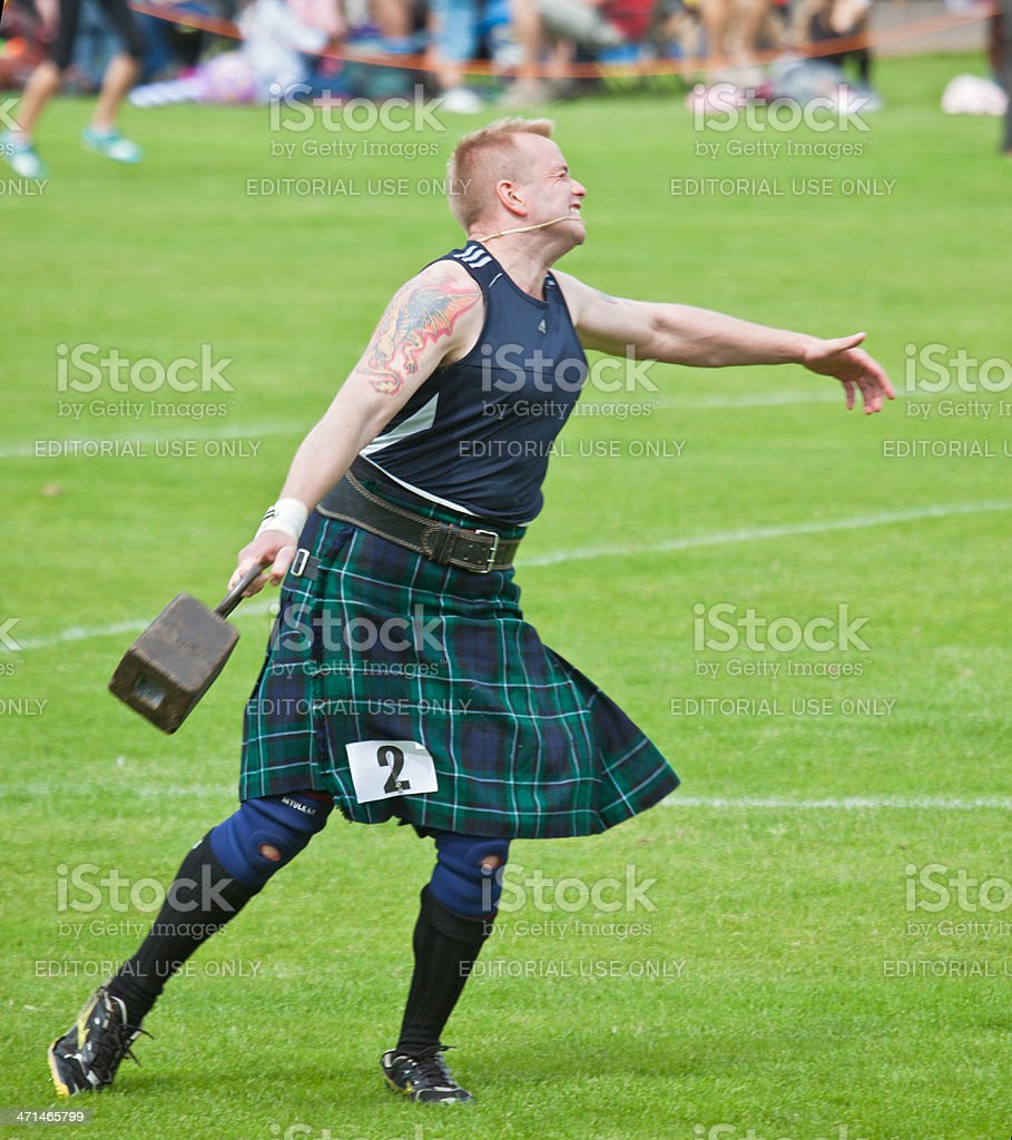 Effort shown by heavy athlete: 56lb weight competition; Highland Games stock photo