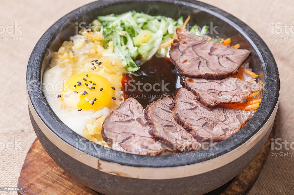egg and  beef meat in hot stone pot stock photo