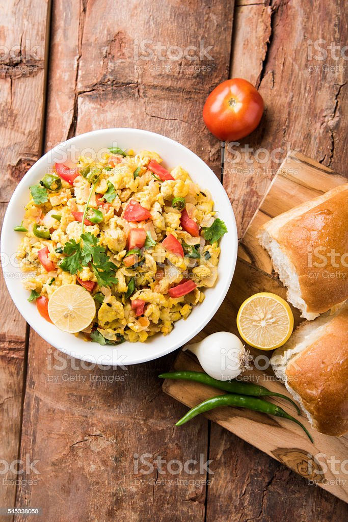 egg anda bhurji or Spicy scrambled eggs and bread stock photo