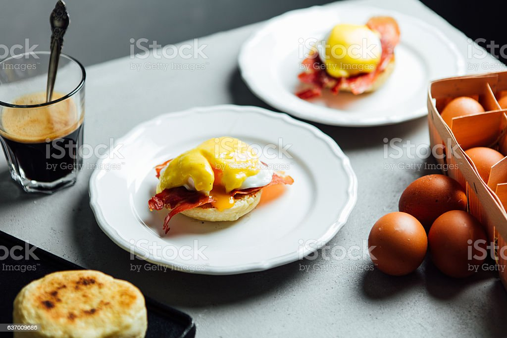 Egg benedict coated with hollandaise sauce stock photo