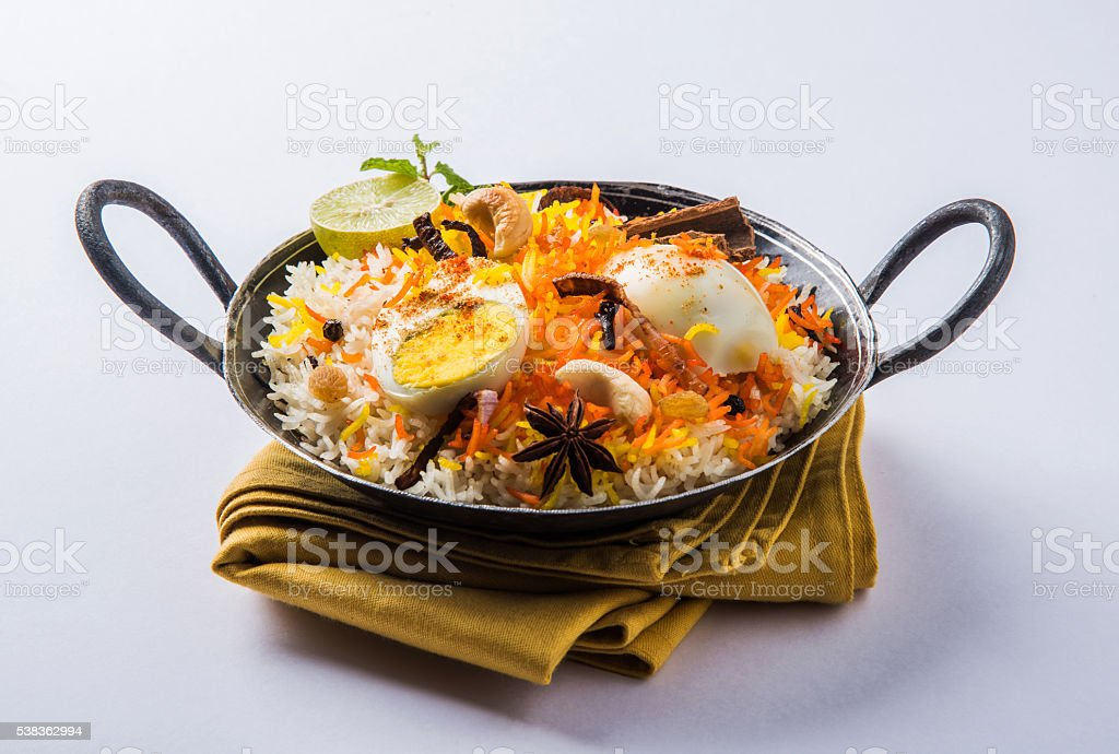 egg biryani or anda biryani using basmati rice and spices stock photo