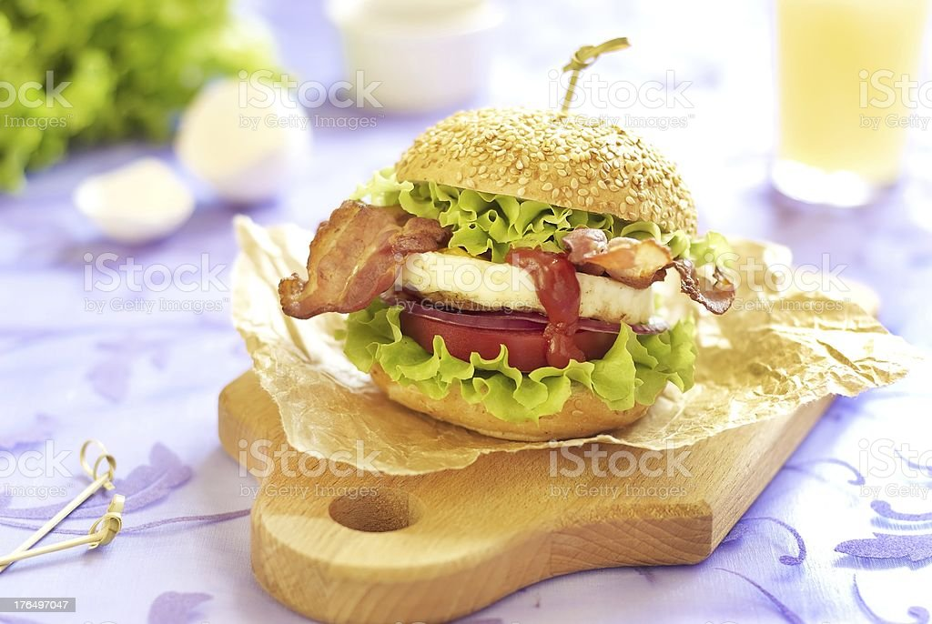 Egg burger with tomato, salad, onion and bacon royalty-free stock photo