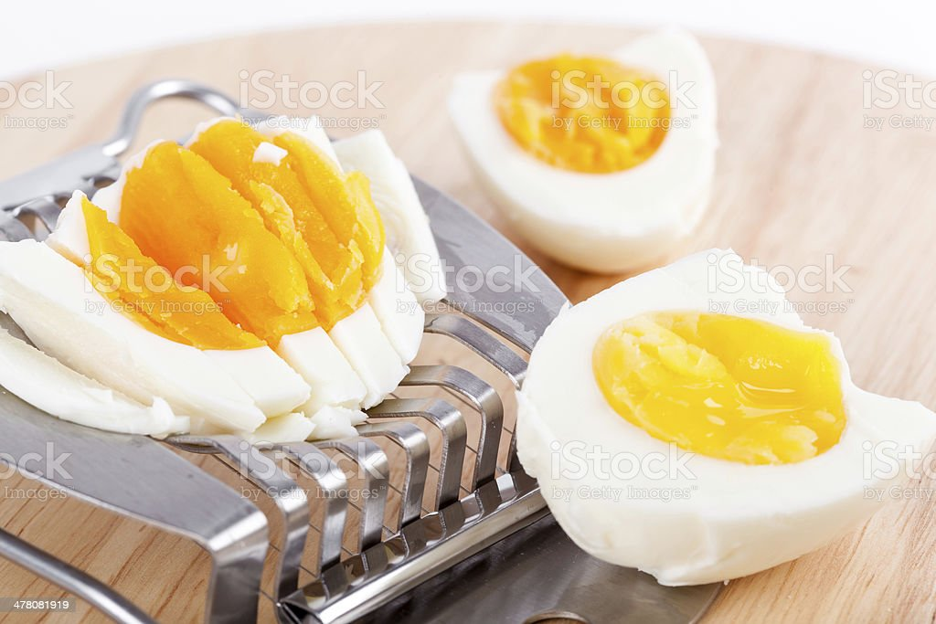 Egg cutter and cutted eggs on board royalty-free stock photo