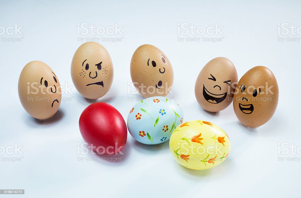 Egg faces and some easter eggs stock photo