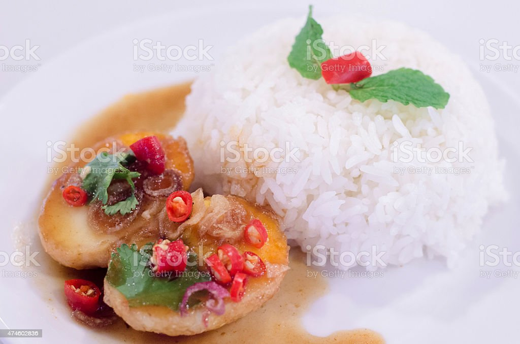 egg fried with tamarind sauce stock photo