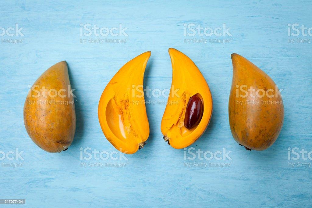 Egg fruit on wooden blue background stock photo