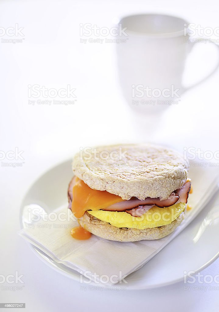 Egg, ham and cheese on whole wheat English muffin stock photo
