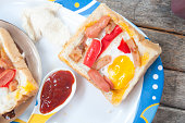 Egg, hotdog and crab stick in a hole of bread
