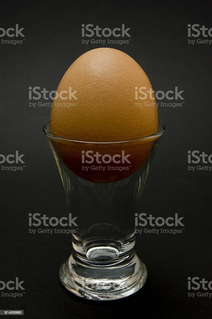 Egg in a Shot Glass on Black royalty-free stock photo