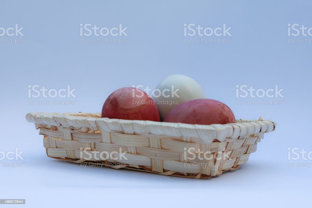 Egg in  basket wicker on white background stock photo