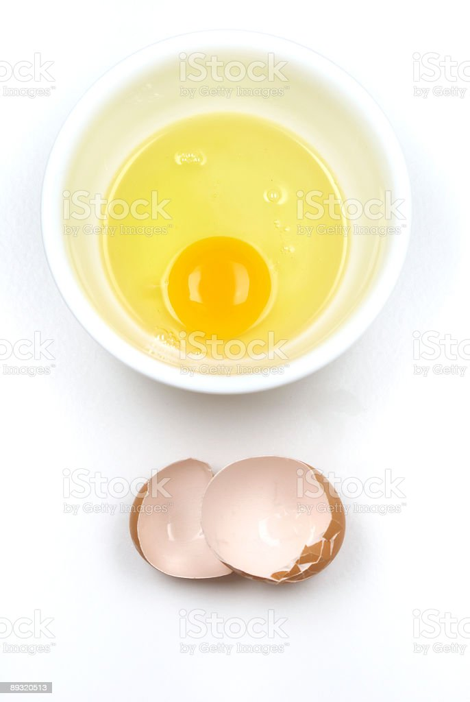 Egg in bowl with shell beside royalty-free stock photo
