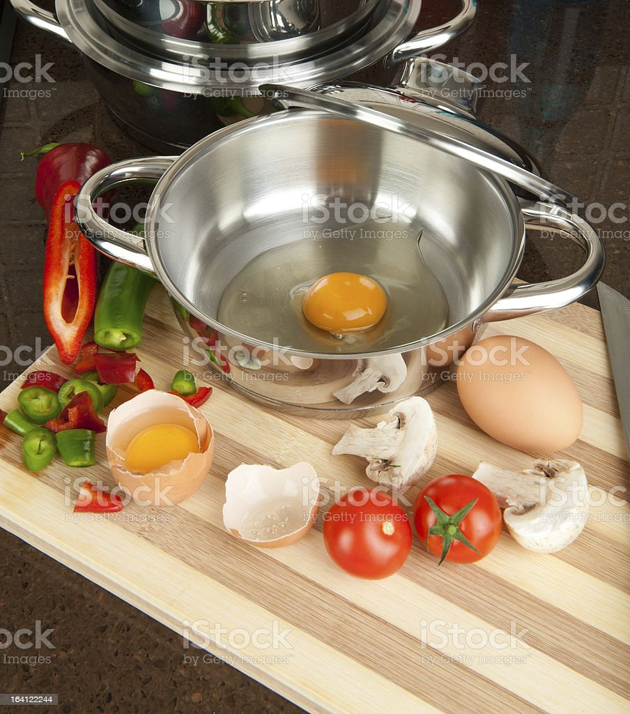 Egg in cooking pan stock photo