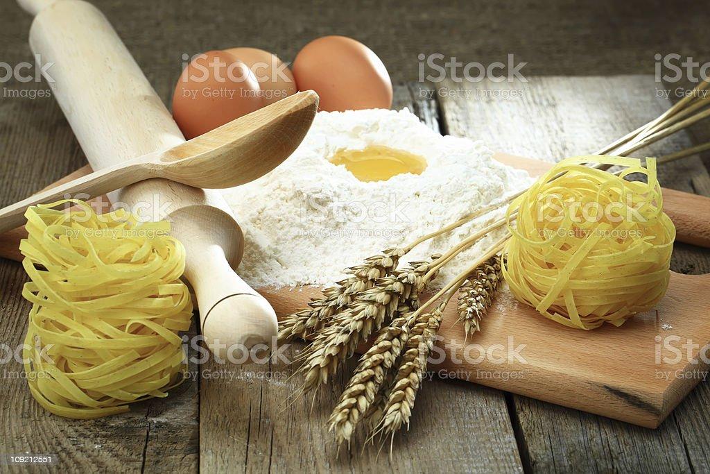 Egg into flour royalty-free stock photo