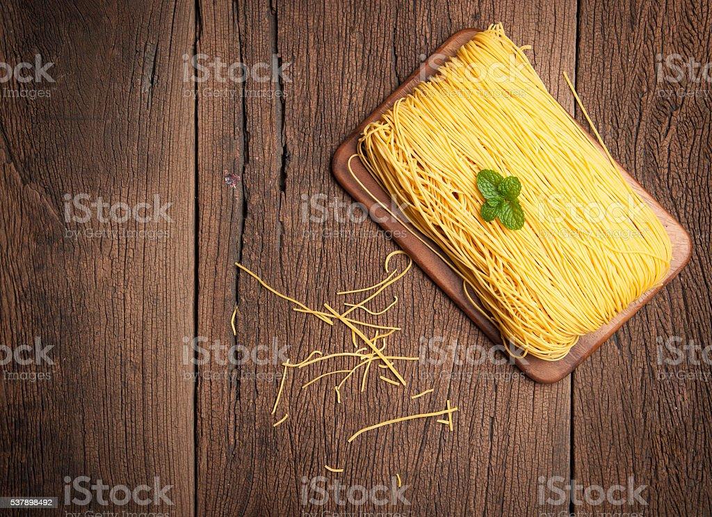 Egg noodles on wood background stock photo