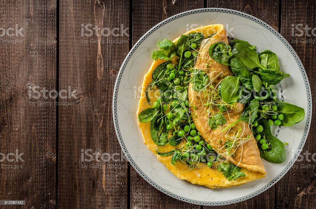 Egg omelette with herbs stock photo
