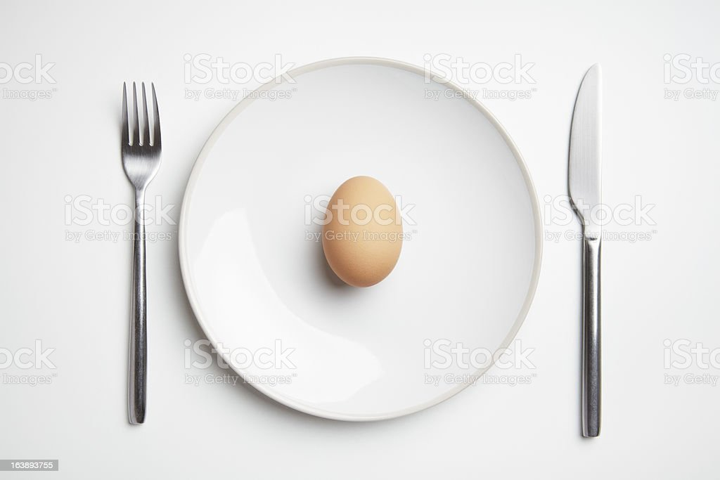 Egg on plate with knife and fork royalty-free stock photo