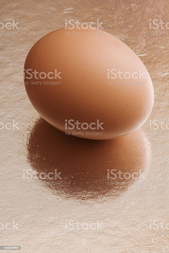 Egg on rough reflecting surface royalty-free stock photo