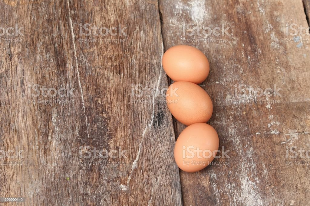 egg on wood background stock photo