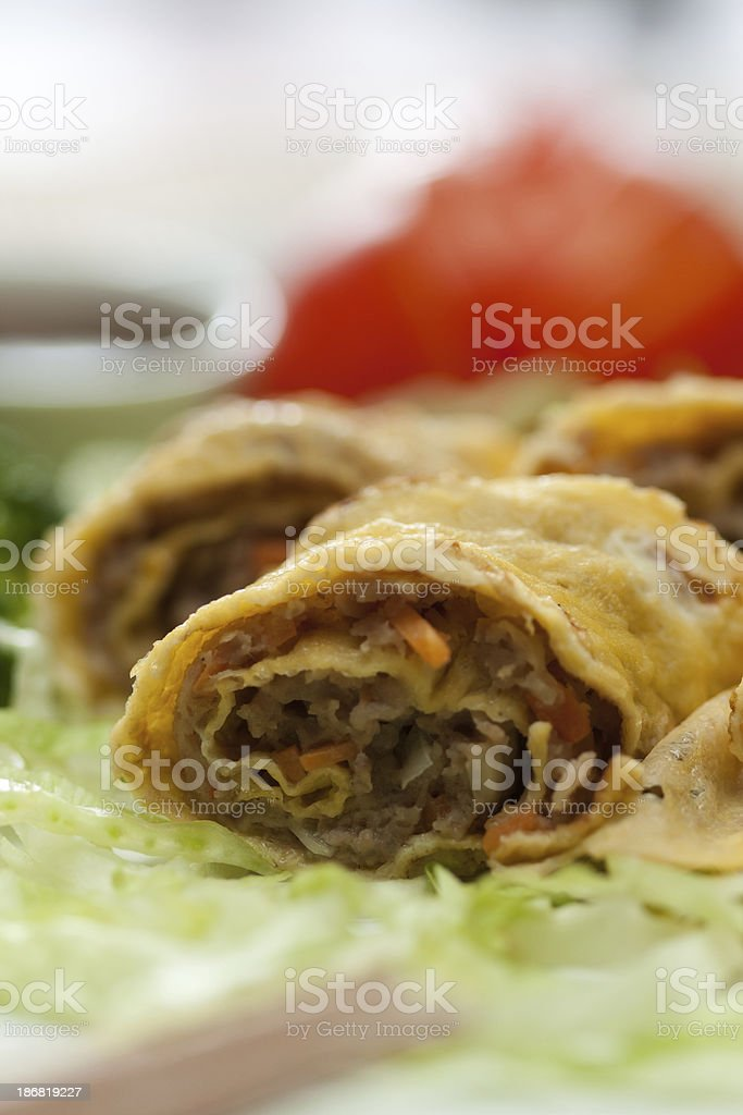 Egg rolls with beef closeup stock photo