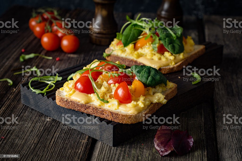 Egg salad sandwich with tomato and spinach stock photo