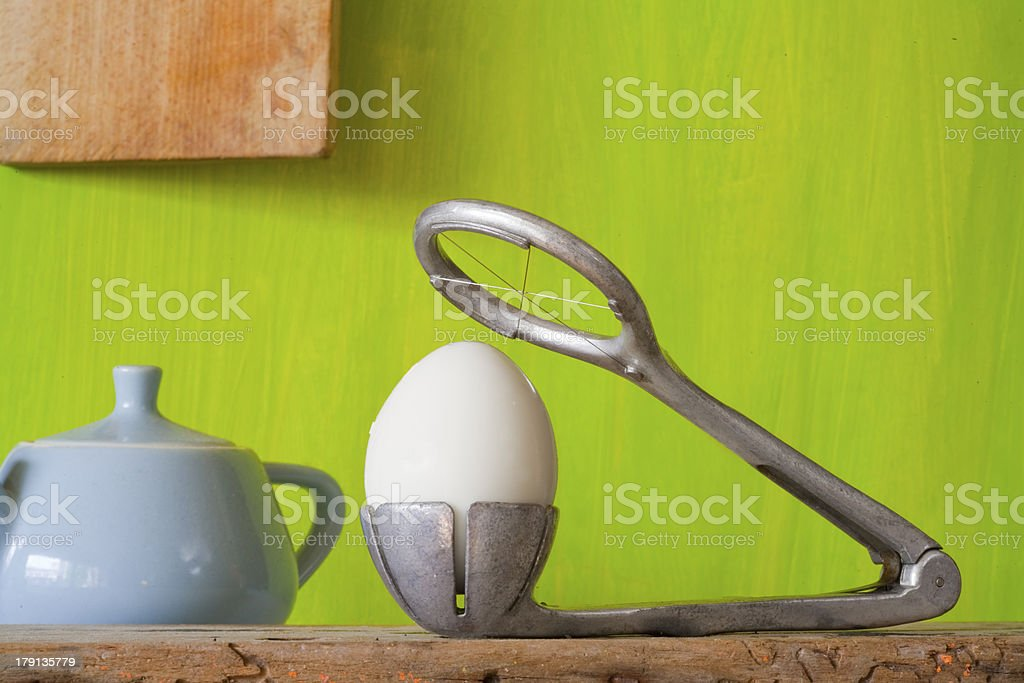 egg slicer and vintage kitchen utensils royalty-free stock photo