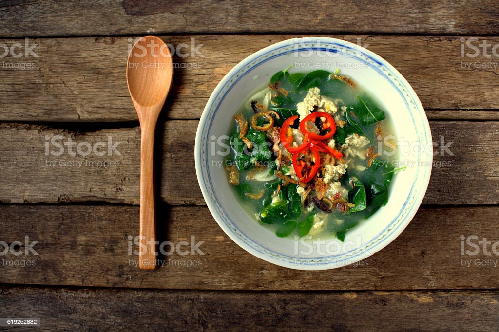 Egg soup with vegetables Asian Style on wooden background stock photo