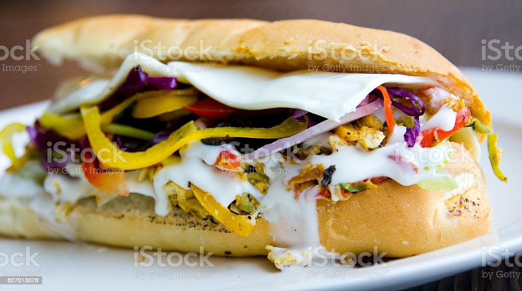 Egg sub sandwich with mayo, onions, peppers and more stock photo