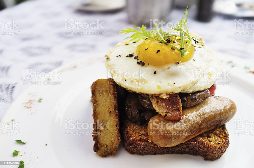 Egg, toast, bacon, sausage, mushroom, hash browns makes complete breakfast royalty-free stock photo