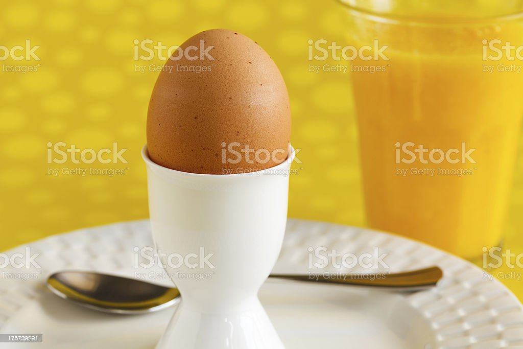 Egg with Spoon and Glass of Orange Juice royalty-free stock photo