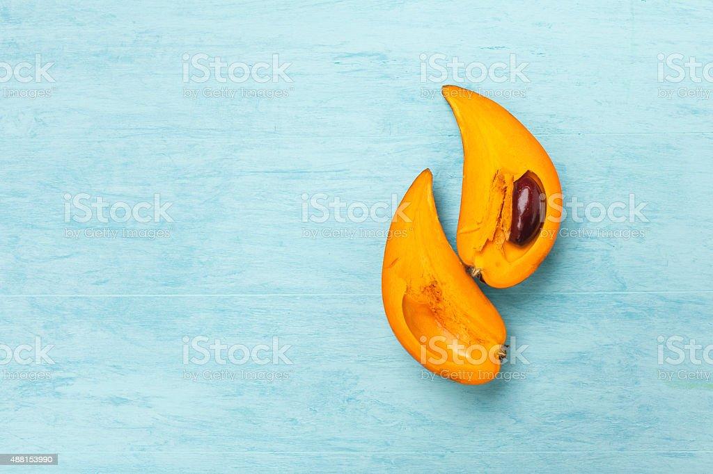 Eggfruit on blue background stock photo