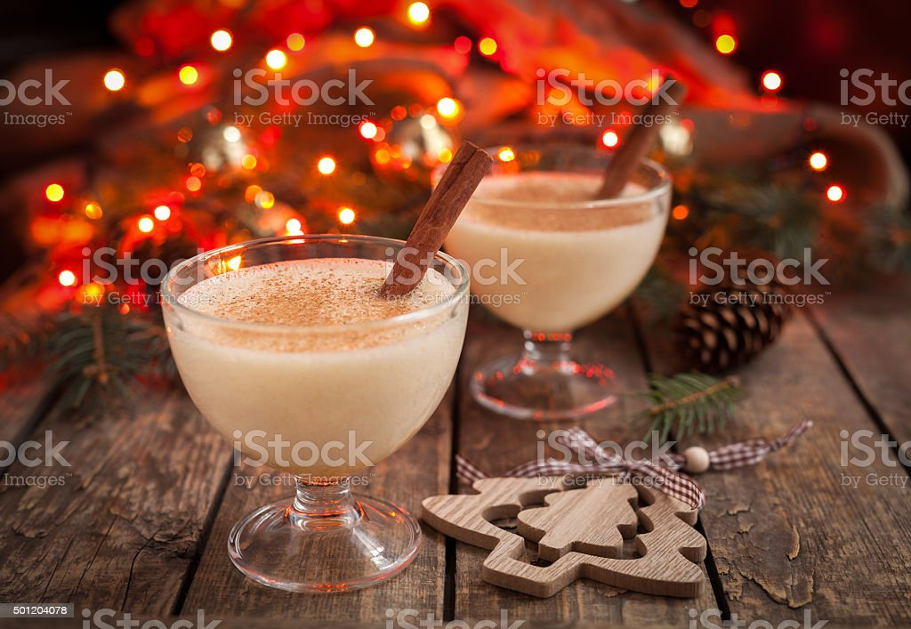 Eggnog traditional christmas egg, vanilla rum alcohol drink liqueur preparation stock photo