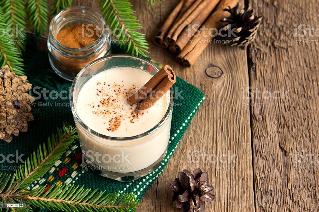 Eggnog with cinnamon stock photo