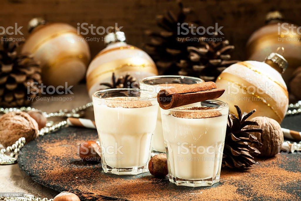 Eggnog with milk, cinnamon, grated nutmeg stock photo