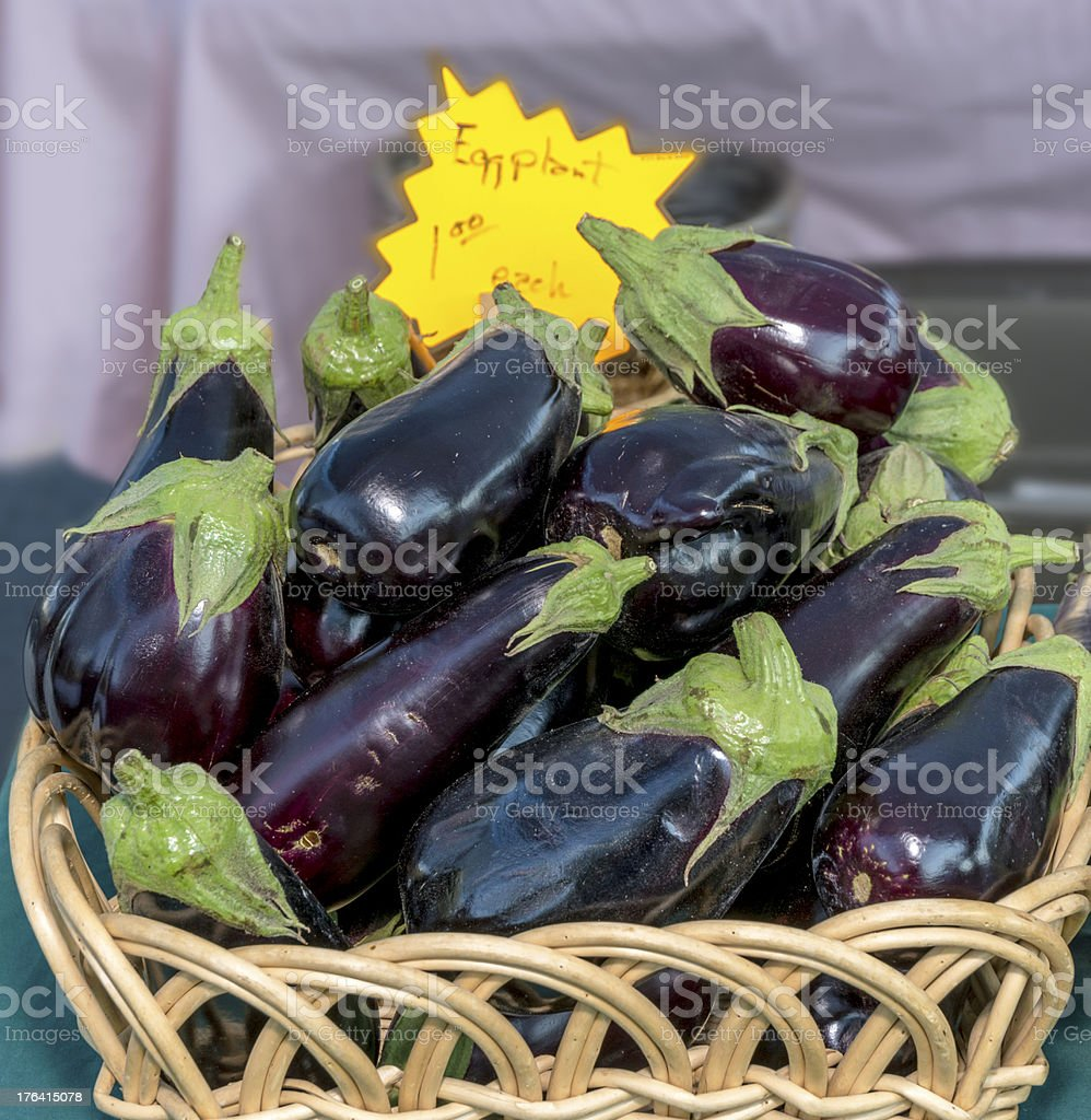 Eggplant at a farmers market in basket royalty-free stock photo