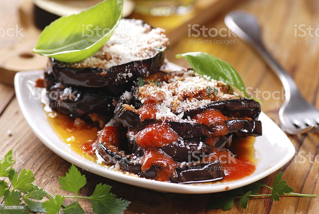 eggplant parmesan in the dish stock photo