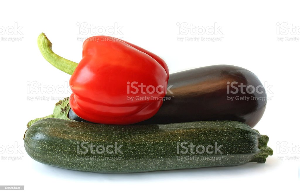 Eggplant, peppers and zucchini on a white background royalty-free stock photo