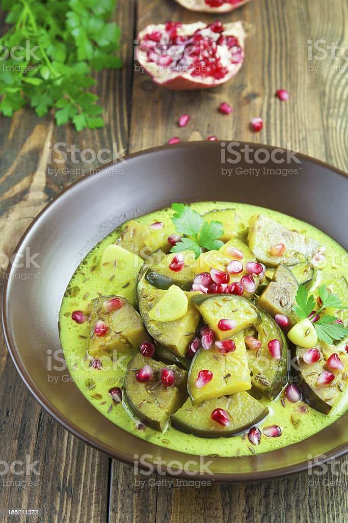 Eggplant with pomegranate and cumin royalty-free stock photo