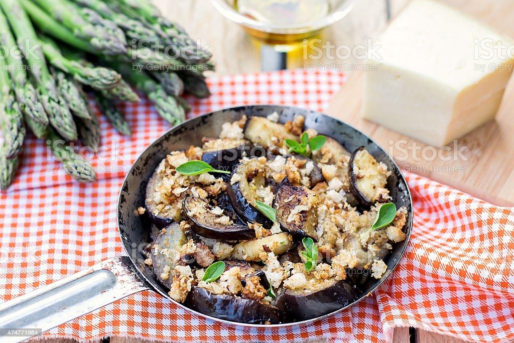 Eggplants aubergines saut?ed with breadcrumbs and cheese stock photo