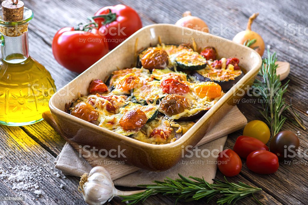 Eggplant,zucchini and tomato with mozzarella in Casserole stock photo