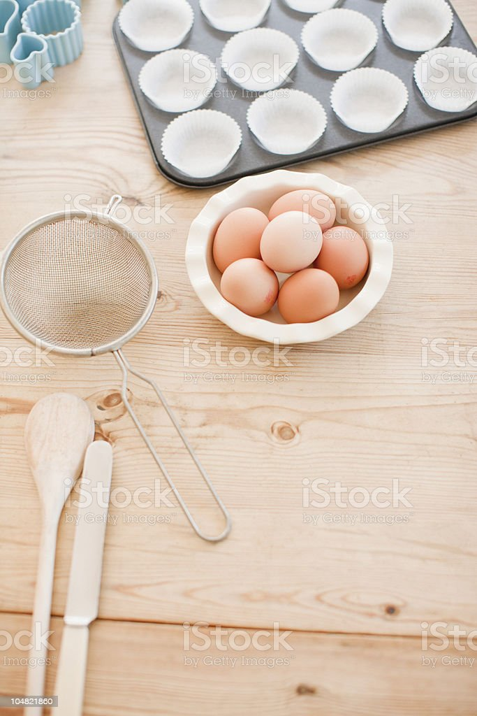 Eggs and baking supplies on table stock photo