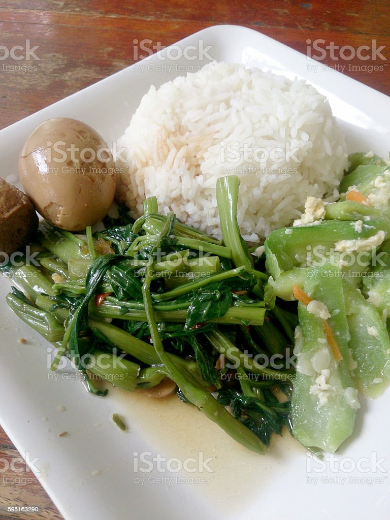 Eggs and pork in brown sauce frogs , stock photo