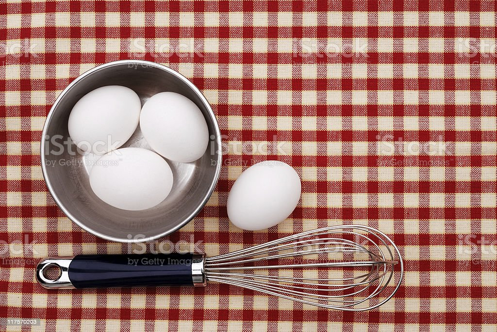Eggs and wire whisk stock photo