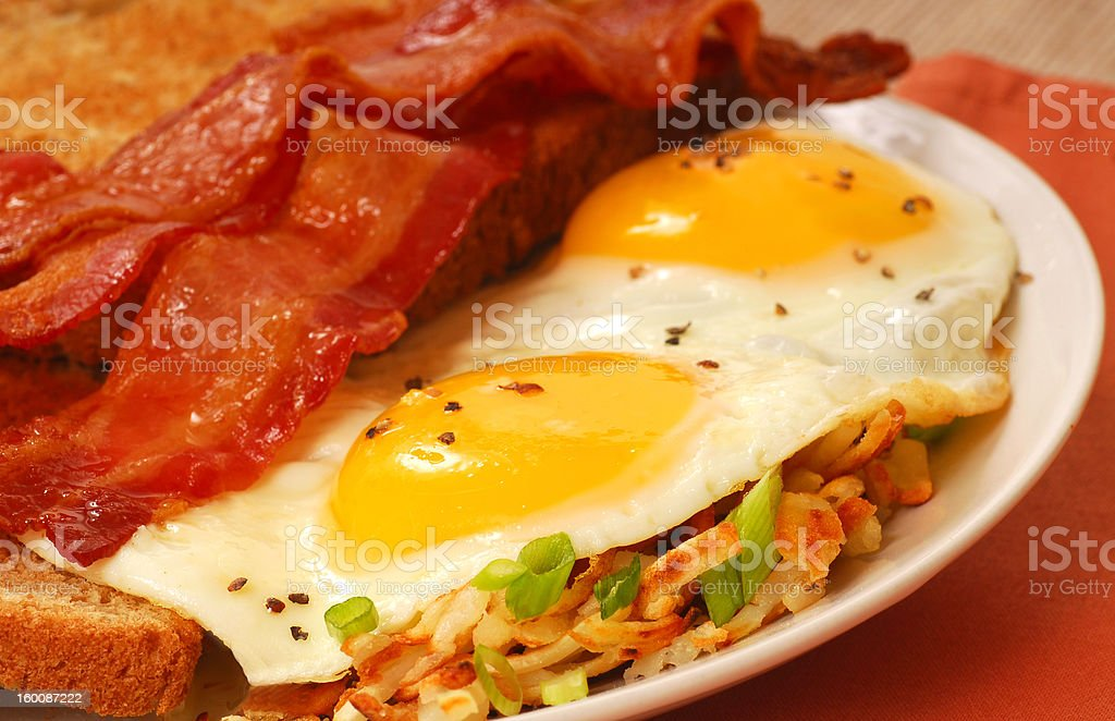 Eggs, bacon, toast and hash browns stock photo