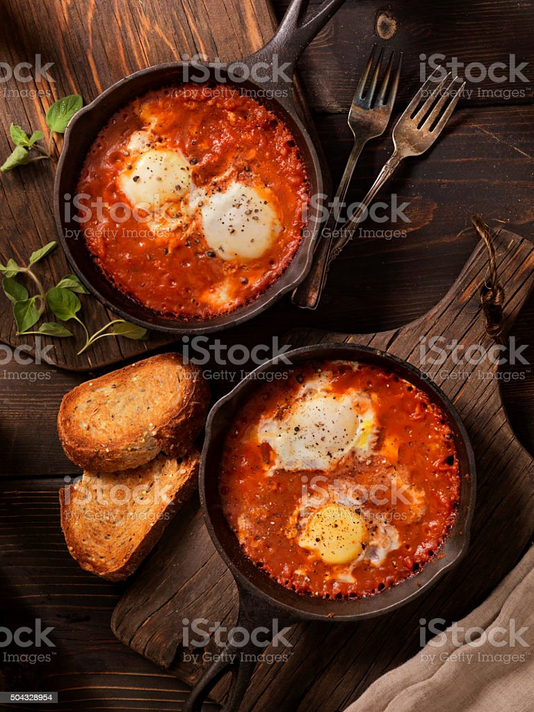 Eggs Baked in Spice Tomato Sauce stock photo