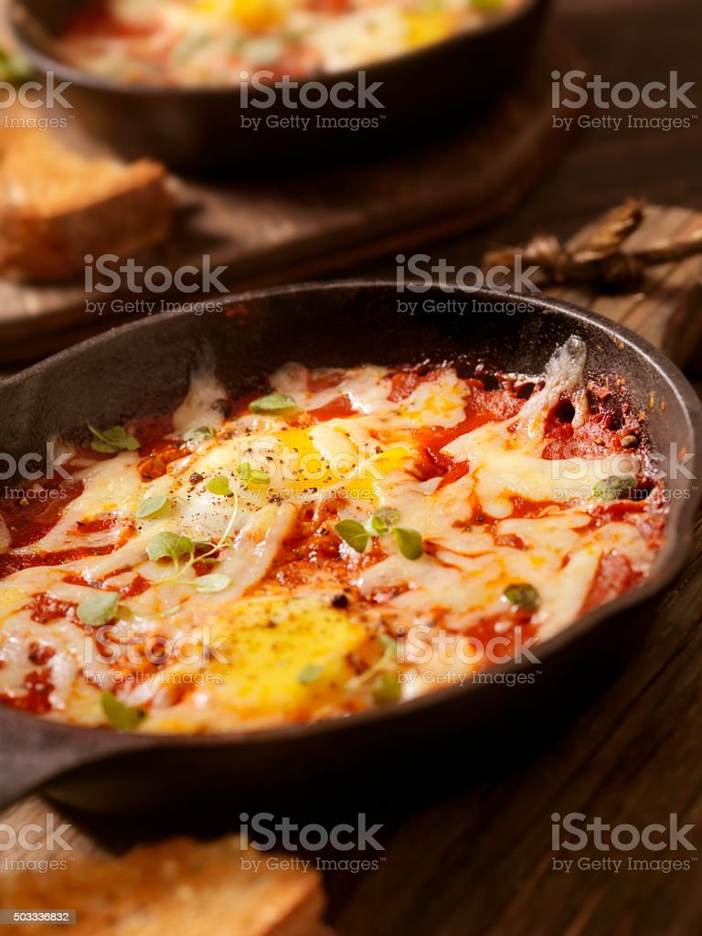 Eggs Baked in Spice Tomato Sauce with Mozzarella Cheese stock photo
