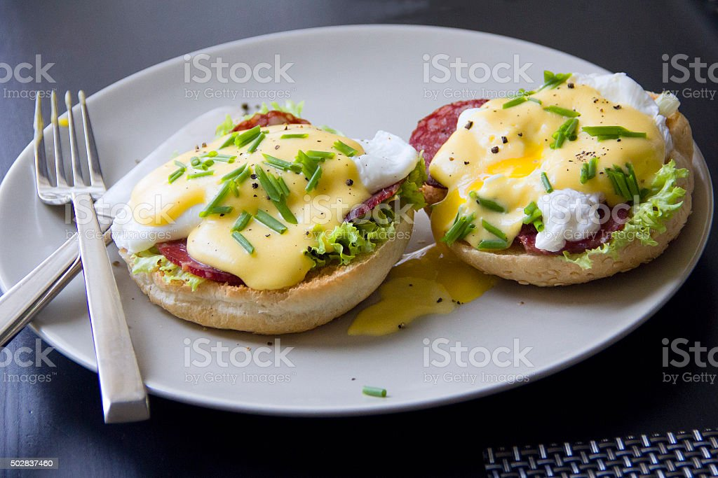 Eggs Benedict against a dark background. stock photo