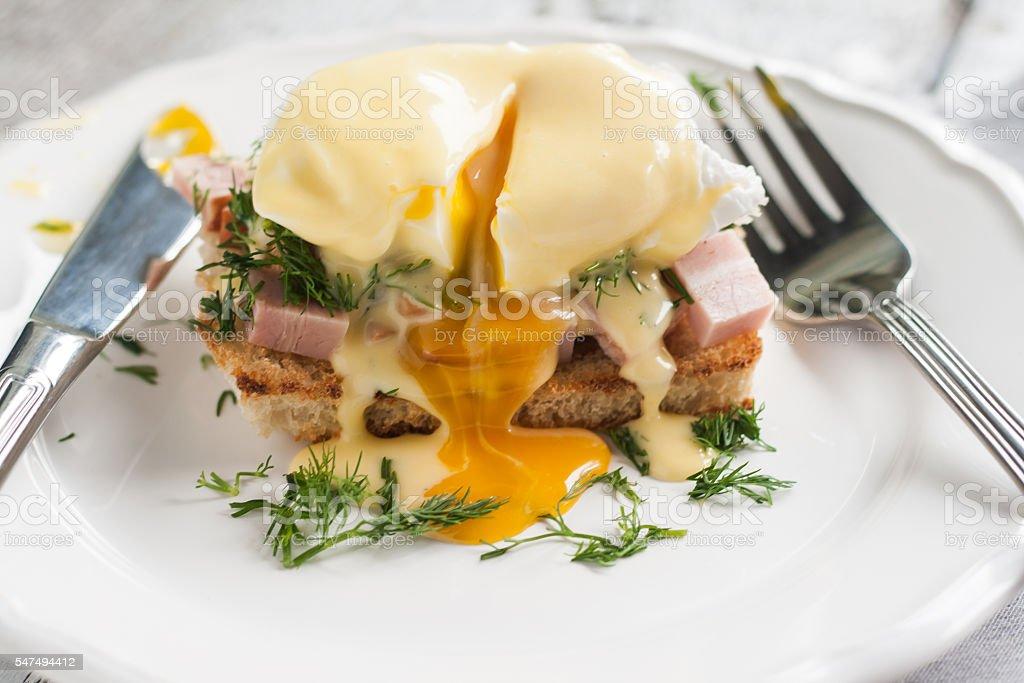 eggs Benedict in the context of a hollandaise sauce stock photo